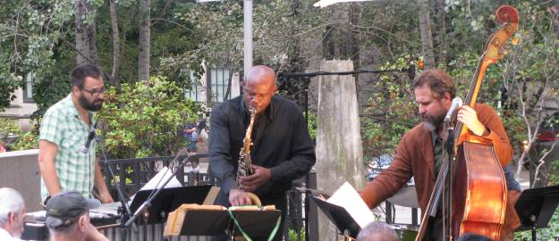Jason Adasiewicz, vibraphone; David Boykin, saxophone; Joshua Abrams, double bass; and Frank Rosaly, drums; performing at the Museum of Contemporary Art's Tuesdays on the Terrace in Chicago, Illinois