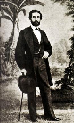 Foto de Gustavo Adolfo Bécquer agarrando su sombrero y bastón