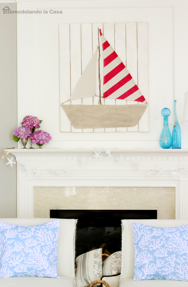 blue pillows, starfish garland, mantel, boat
