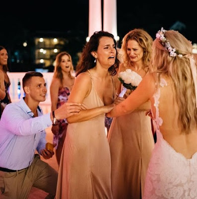 WOW: Bride Helps Her Bridesmaid's Boyfriend Propose at Her Own Wedding (Photo)