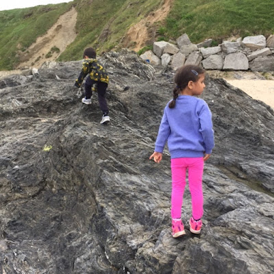 Children climbing rocks in Cornwall