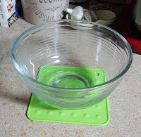 Use a silicon hotpad to keep the bowl from moving around