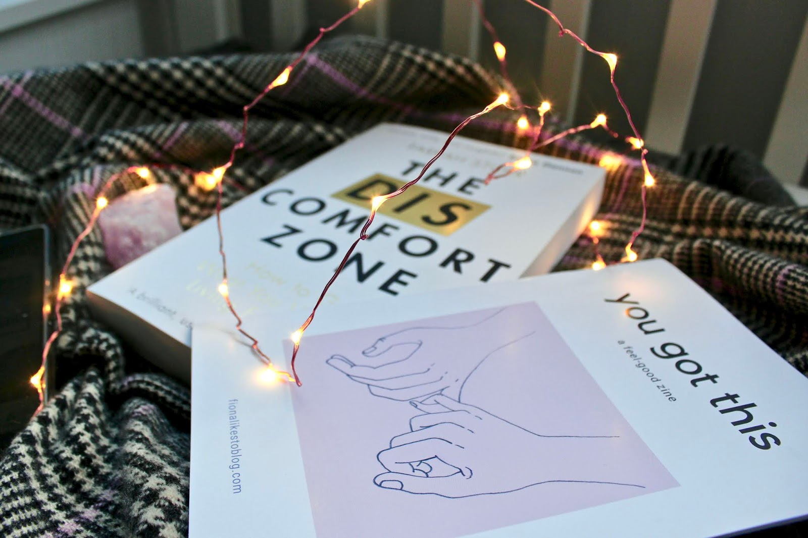 The Discomfort Zone book, a mindfulness app and some pink fairy lights
