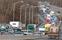 A traffic jam on the Massachusetts Turnpike. The state's transportation and energy sectors must show annual emissions reductions under rules published by MassDEP on Aug. 11, 2017. (Credit: Republican File   Mark M. Murray) Click to Enlarge.