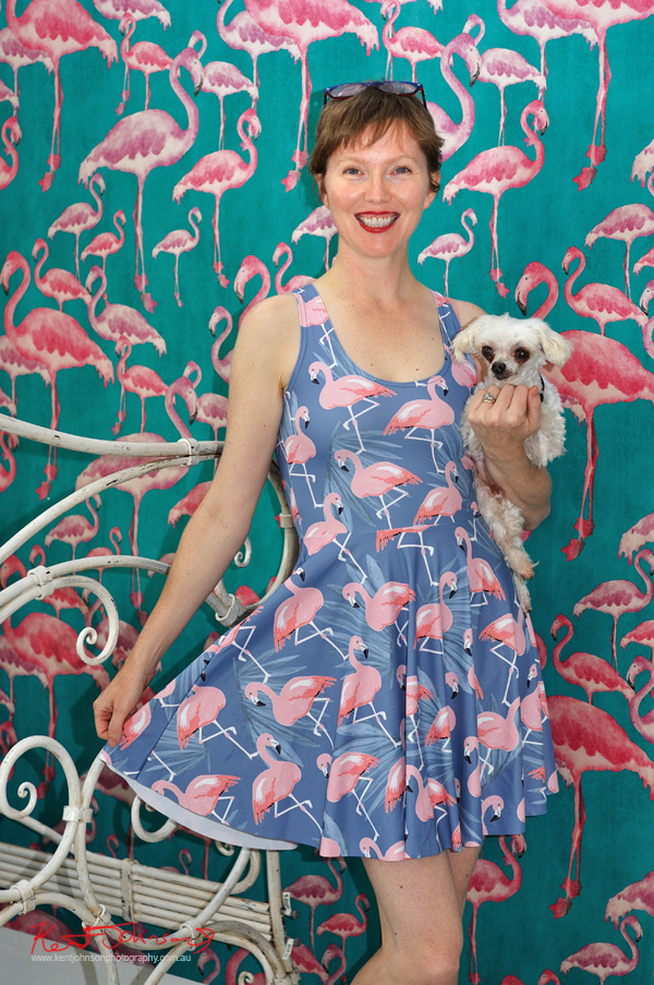 Pink Flamingo dress against Pink Flamingo wall paper & a rescue chihuahua dog at Danks Street, Street Fashion Sydney by Kent Johnson.