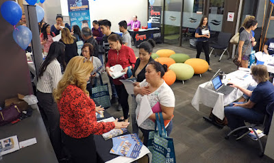 Image of College Info night attendees talking to Maricopa Colleges staff