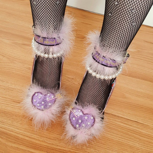 close up of feet wearing feather heart shoes with pearl ankle strap