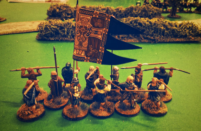 Scots warriors with a war banner