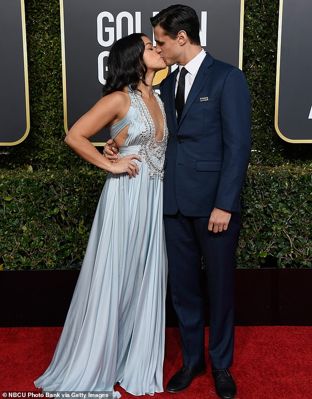 Gina Rodriguez and fiance Joe LoCicero pack on the PDA at Golden Globes