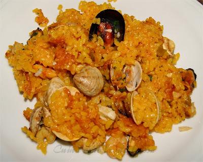 http://cuinaamblamestressa.blogspot.com.es/2013/07/arroz-al-horno-con-marisco.html