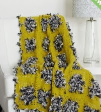 http://www.yarnspirations.com/pattern/crochet/throw-loop