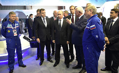 Vladimir Putin talks to test pilots of the new MS-21 airliner at the International Aviation and Space Salon MAKS-2017.