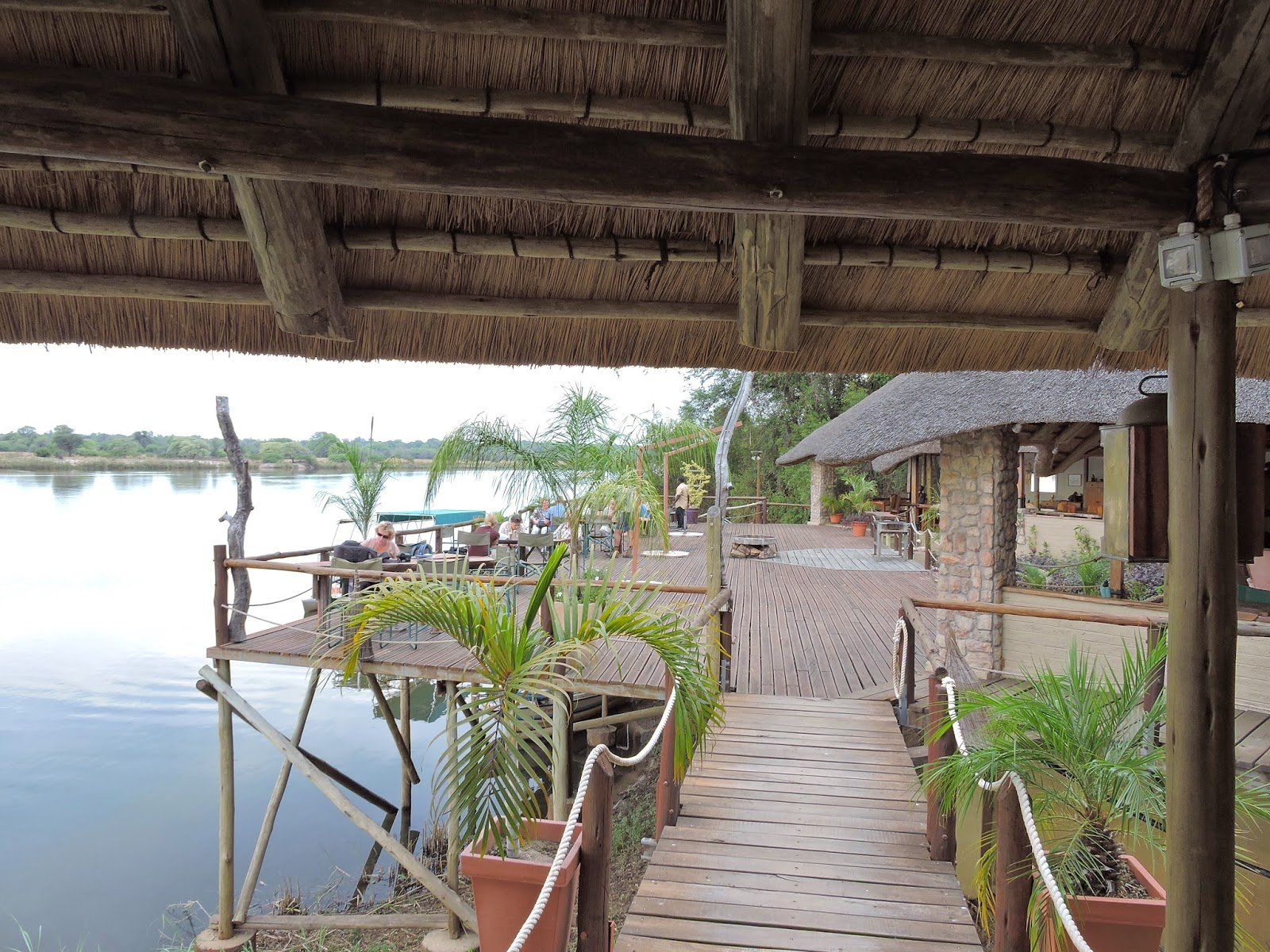 A wooden deck with the Okavango River visible on the photograph.
