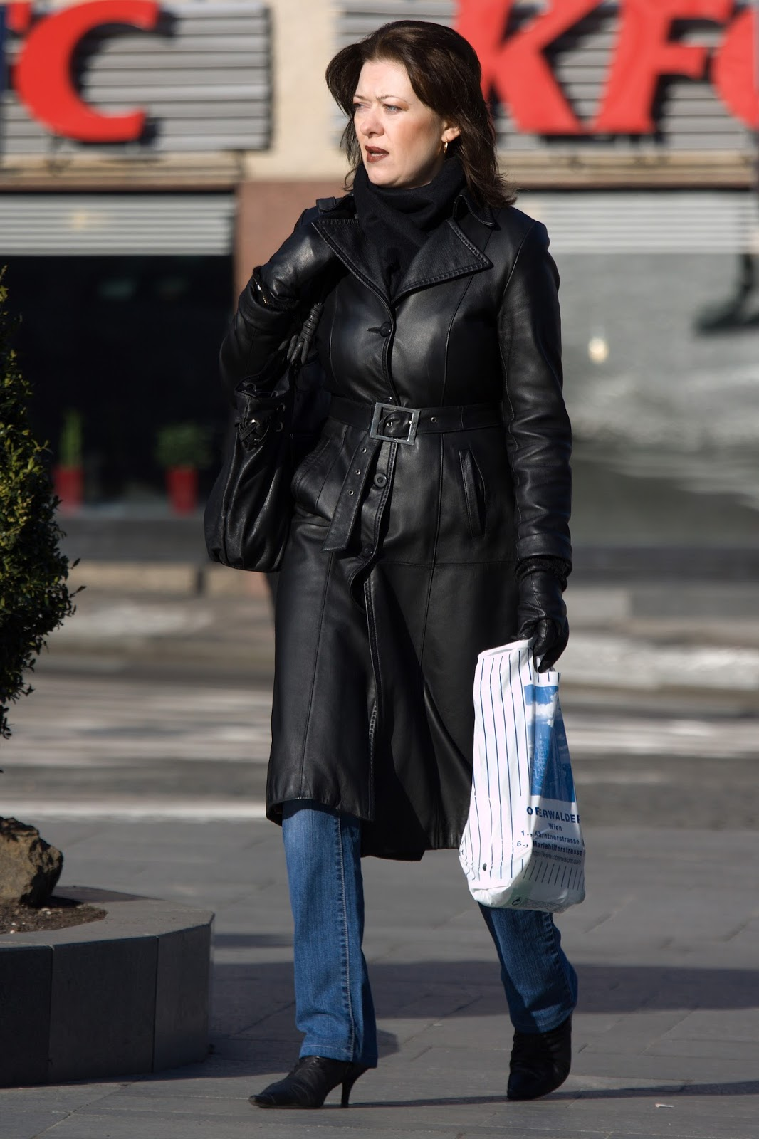 Leather Coat Daydreams: A pretty woman in a leather coat