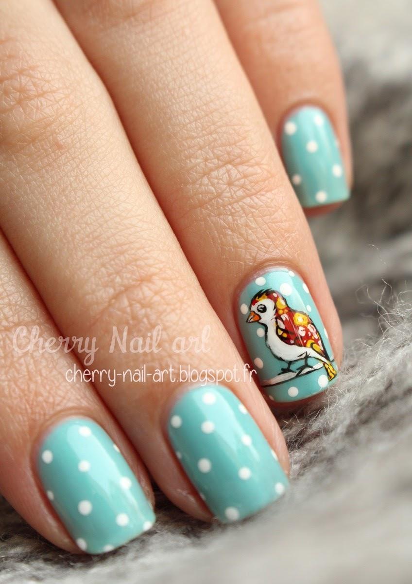 nail art oiseau à motif sous la neige