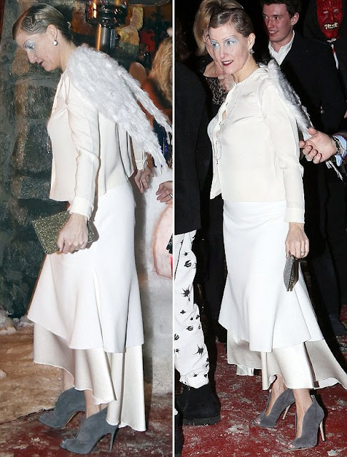 The Countess wore a layered white skirt by Ellery- Suzie, a cream blouse by Emilia Wickstead which se had worn before a few times and a gray suede boot by Gianvito Rossi.