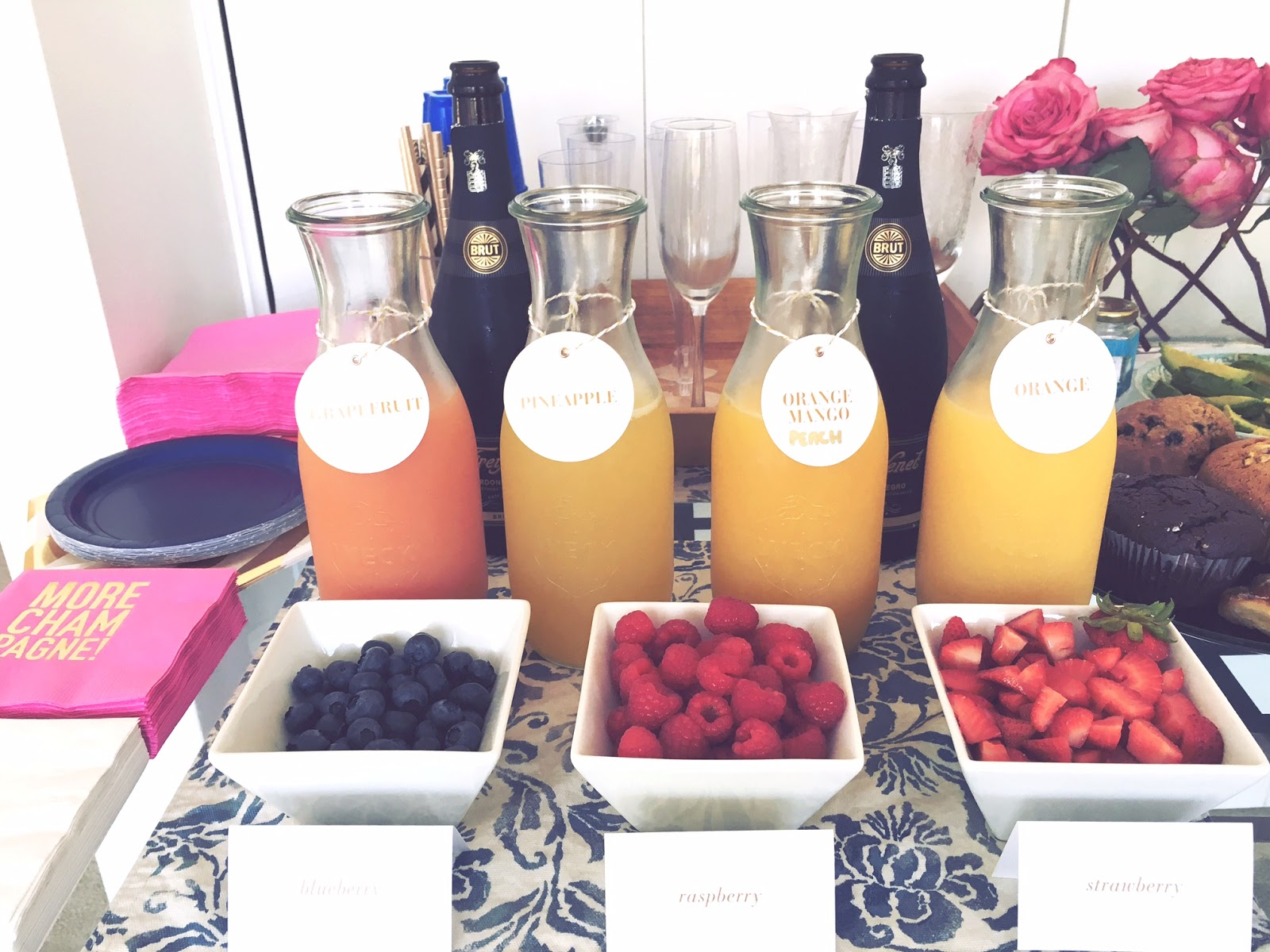Juices and fruit for mimosa bar