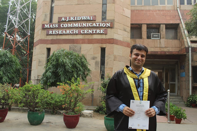 Posing with my MA (Mass Communication) degree after the Jamia Millia Islamia convocation ceremony