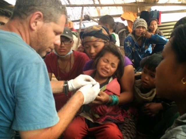 Giving first aid to victims of earthquake