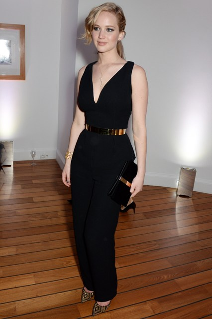Jennifer Lawrence wore a Christian Dior Couture black silk jumpsuit with a gold metal Dior belt, Brian Atwood heels and a Roger Vivier clutch at Cannes 2014