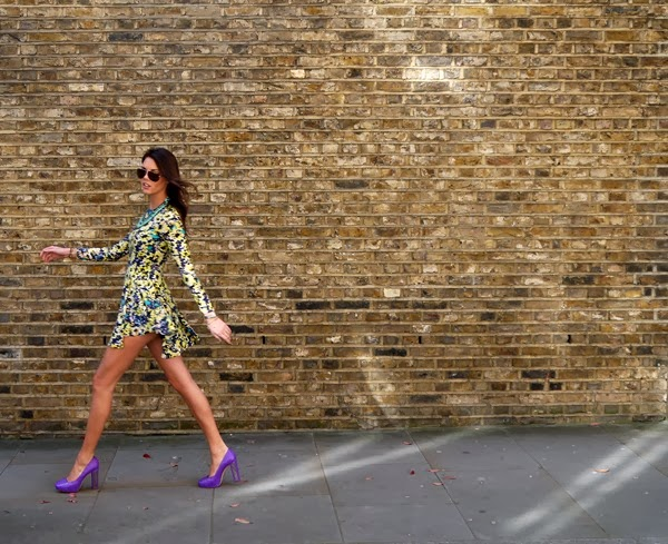 H&M floral dress and Christian Dior purple heels on a sunny day in Mayfair