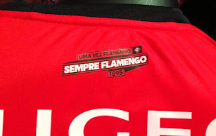 5dfe8a24700 Under the collar on the back of the Flamengo 2013 Home Kit features the  lettering Uma vez Flamengo Sempre Flamengo