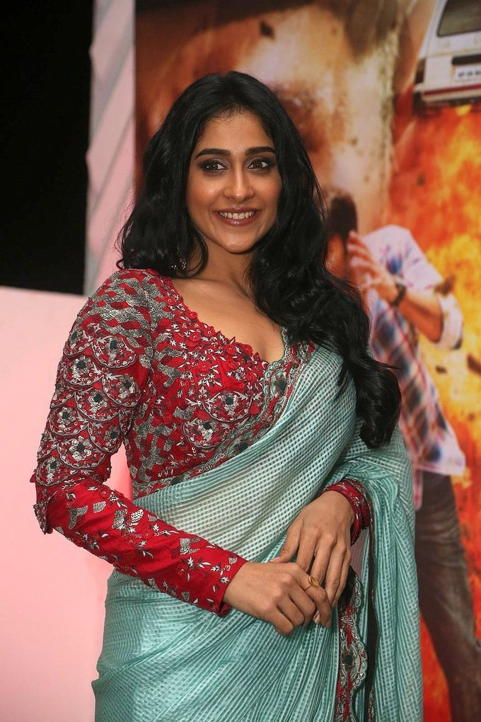 Regina Cassandra Stills At Nakshatram Movie Audio Launch In Green Saree