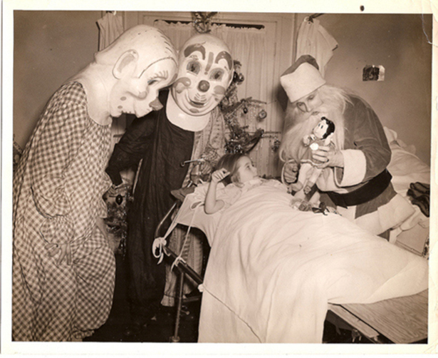 Santa visits a little girl in the hospital with two very creepy clowns. c. 1950s. A Pleasant Christmas Story and other stories of Christmas Creepers. marchmatron.com