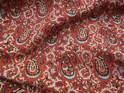 Red Termeh textile with paisley forms. Iran