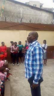 Pastor Animashaun admonishing the pupils