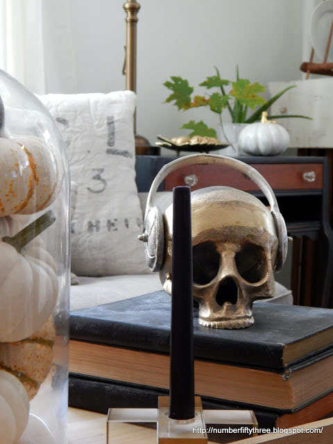 Skull wearing a head set on coffee table decor