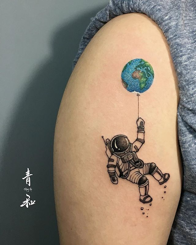 earth tattoo and space suit