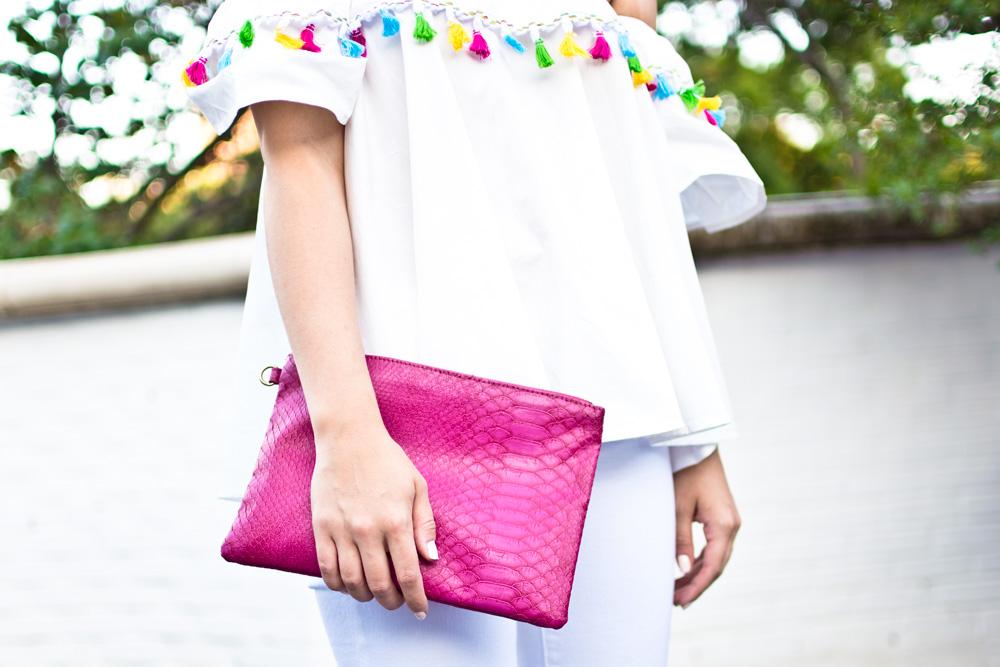 pink snakeskin clutch