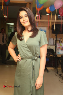 Actress Raashi Khanna Stills in Green Short Dress at Mirchi 95 Suno Aur Mercedes Jeeto Contest  0065.JPG