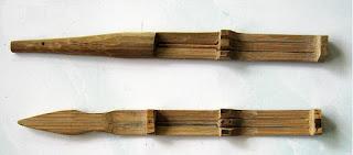 """Karinding adalah sebuat alat musik tiup tradional sunda yang berukuran 20 x 1 cm ini digunakan oleh para karuhun untuk mengusir sepi sekaligus mengusir hama di sawah-bunyinya yang low decible sangat merusak konsentrasi hama. Karena ia mengeluarkan bunyi tertentu, maka disebutlah ia sebagai alat musik.beberapa sumber menyatakan bahwa karinding telah ada bahkan sebelum adanya kecapi, jika kecapi telah berusia lima ratusan tahunan .,berarti karinding sudah ada konon antara zaman pertanian dan zaman perundagian antara 10.000-5.000 SM., namun untuk keberadaan di tanah pasundan harus dikonfirmasi lagi  Dan ternyata karinding pun bukan hanya di Jawa Barat atau Priangan saja, melainkan dimiliki diberbagai suku atau daerah di tanah Air, bahkan di berbagai suku bangsa lain pun memiliki alat musik ini seperti china disebut (CHANG),dan nepal, eropa biasanya menyebut dengan (JAWHARP) hanya berbeda nama dan menggunakannya.,di indonesia pun karinding beda nama seperti di ( Bali bernama GENGGONG., Jawa Tengan menamainya RINDING dan di Kalimantan bernama KARIMBI ) dan beberapa di """"luar"""" negri menamainya dengan ZUESHARP ( HARPANYA DEWA ZEUS ) dan istilah musik modern biasanya menyebut karinding ini dengan harpa mulut atau ( MOUTH HARP. )  Dari sisi produksi suara pun tak jauh berbeda, hanya cara memainkannya saja yang sedikit berlainan; ada yang di trim (di getarkan dengan di sentir), di tap ( dipukul), dan ada pula yang di tarik dengan menggunakan benang. Sedangkan karinding yang ada di tataran Sunda dimainkan dengan cara di tap atau dipukul., bunyi yang khas tersebut bisa diatur tergantuk bentuk rongga mulut, kedalaman resonasi, tutup buka kerongkongan, atau hembusan dan tarikan nafas., tiga bagian ini merefleksikan juga tiga nilai moral dan ajaran yang terkandung dalam karinding., yaitu : yakin ,sadar, sabar. Dipegang yang yakin, ditabuh yang sabar, dan jika ada suara harus sadar jika itu bukan suara kita. secara kebahasan karinding berasal dari KA dan RINDING., """"KA berarti sumber"""