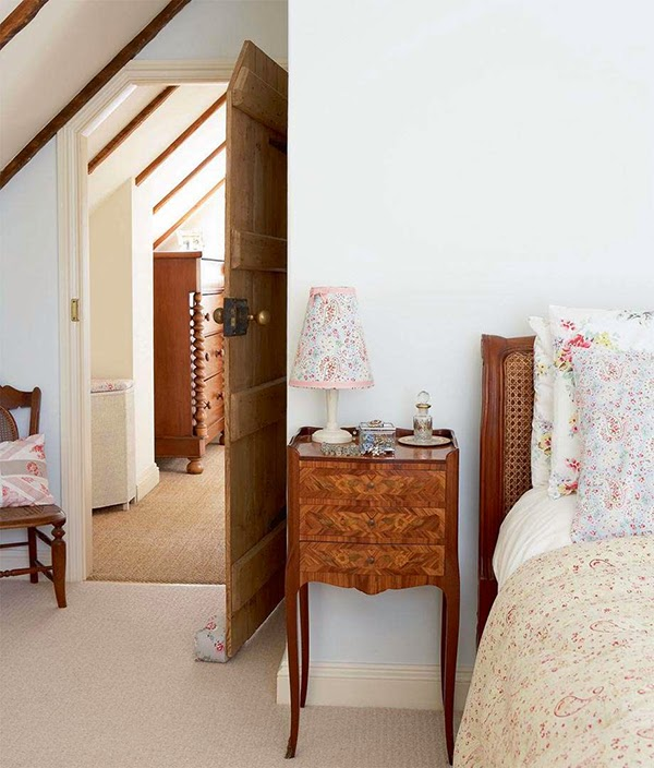 Small cottage bedroom with floral paisley bedding and cath kidston paisley fabric covered lampshades