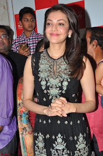 Kajal Aggarwal in lovely Black Sleeveless Anarlaki Dress in Hyderabad at Launch of Bahar Cafe at Madinaguda 007.JPG