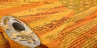 Illustration includes the U.S. Constitution, an American flag, and a police badge.