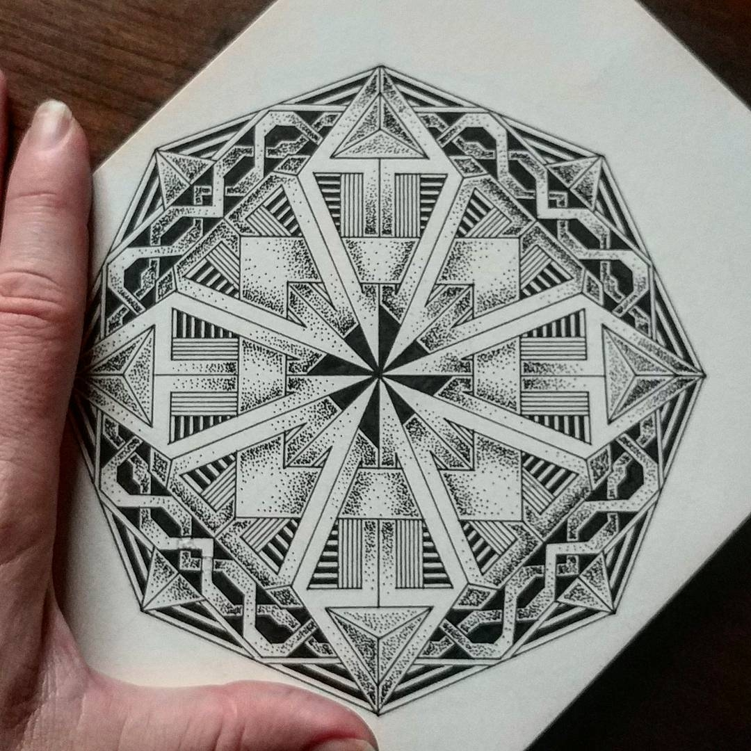 11-Jody-Romero-Symmetry-Balance-and-Harmony-in-Mandala-Drawings-www-designstack-co