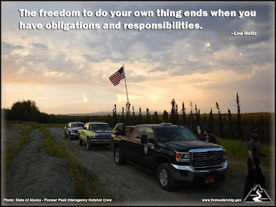 The freedom to do your own thing ends when you have obligations and responsibilities. –Lou Holtz (line of fire vehicles; one with a flag in the back)