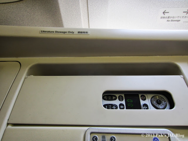 JAL Suite MAGIC-III controller for the inflight entertainment system and menu storage.
