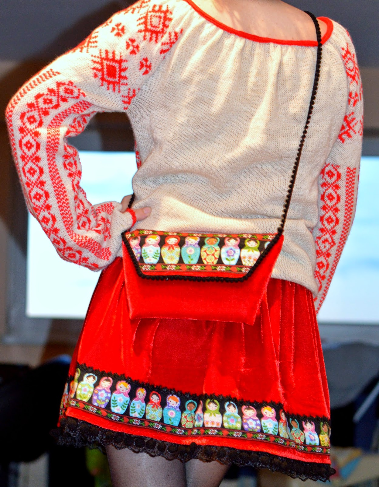 Red velvet matryoshka skirt and clutchwith pop poms and ribbons applique