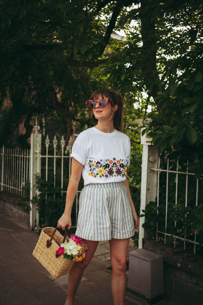 Striped shorts, flowers in basket, embroidered tee, heart shaped glasses