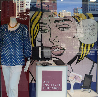 Roy Lichetenstein inspired window display at Hancock Building Best Buy