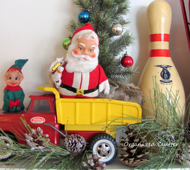 Vintage Toys on the Christmas Mantel www.organizedclutterqueen.blogspot.com