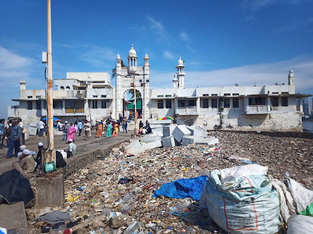 Front of Haji Ali Dargah with rubbish along pathway outside