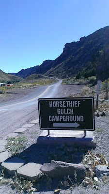 Horsethief Campground Sign with entrance road view