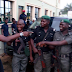 Bovi shares photo with policemen