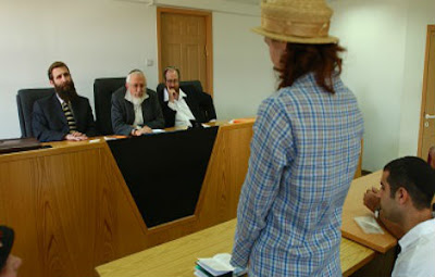 man sues God israel