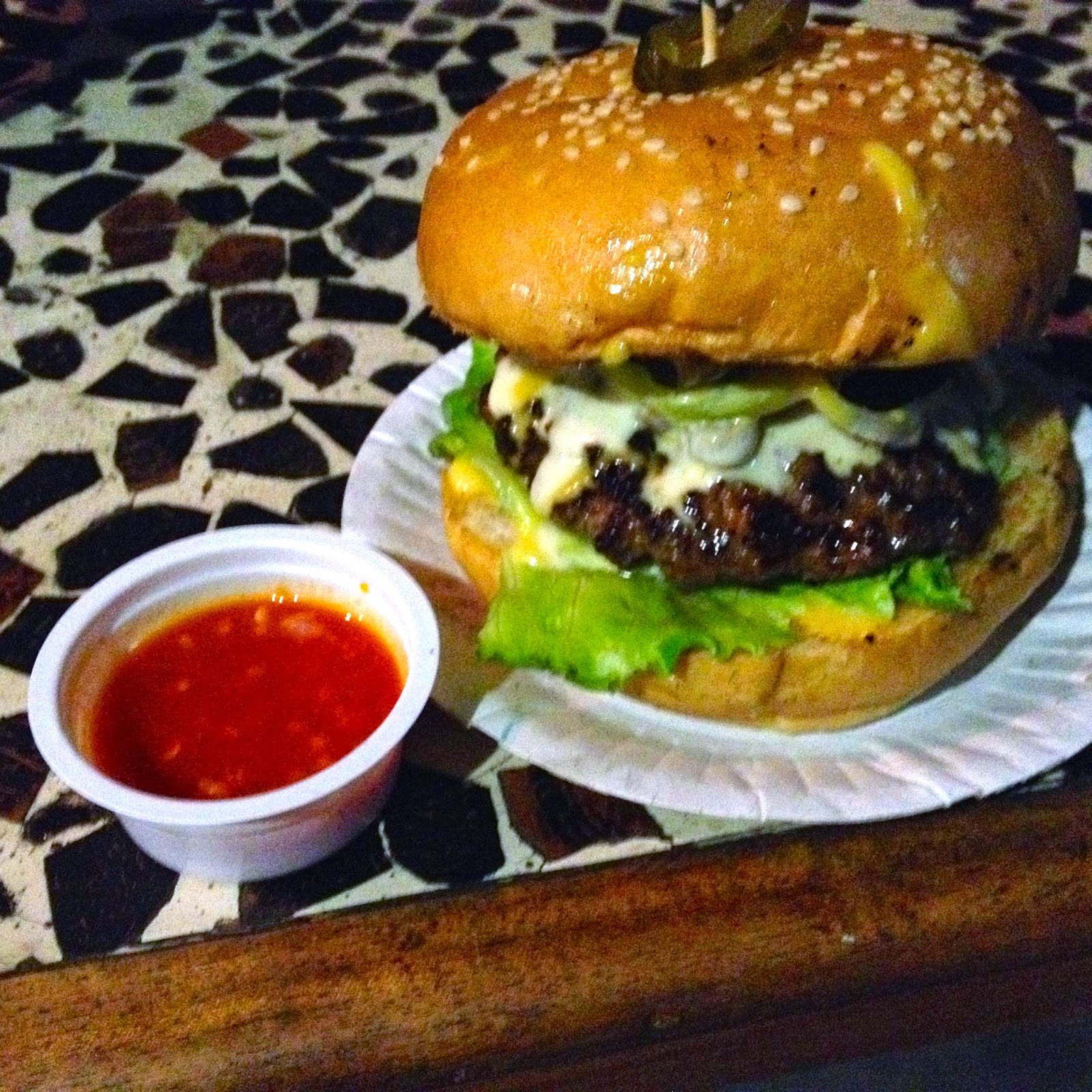 1/4 pound burger at Burgaholic Cebu with home-made hot sauce